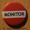 Red Monitor Button Badge