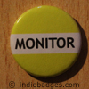 Yellow Monitor Button Badge