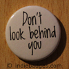 dont look behind you button badge