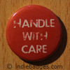handle with care button badge